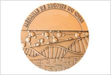 Deux médailles de bronze du CNRS décernées à des chercheurs de la DRF en 2018